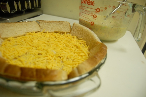 Mixing ingredients for salmon & cheese bake