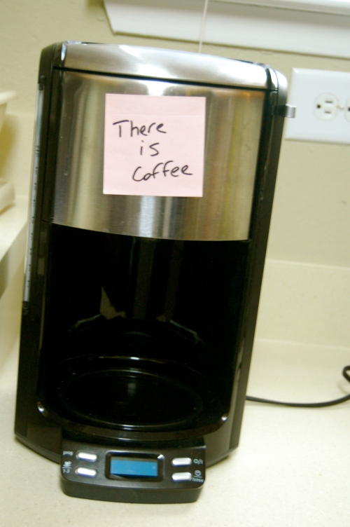 pink note on the coffee maker