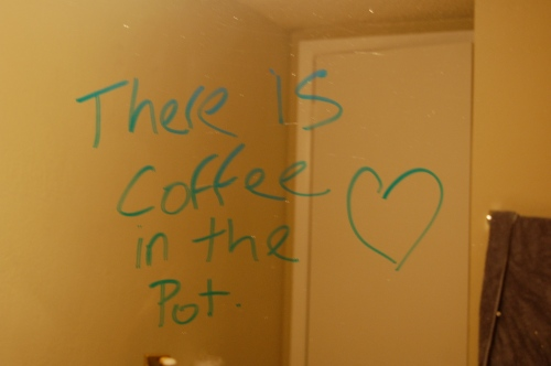note about coffee on the bathroom mirror