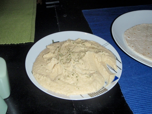 Homemade hummus garnished with parsley and paprika