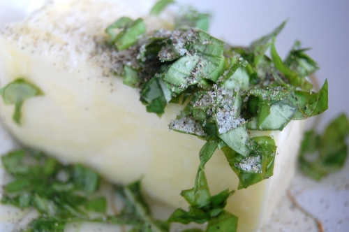 stick of butter with basil, lemon juice, salt and pepper