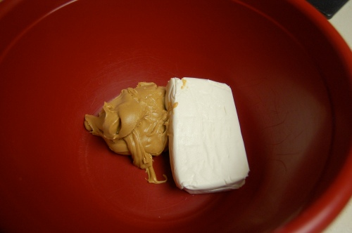 Peanut butter and cream cheese in the mixing bowl