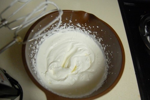 Whipping cream in a mixing bowl